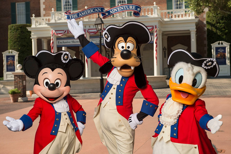 EPCOT: Characters in patriotic apparel plus entertainment and FIREWORKS