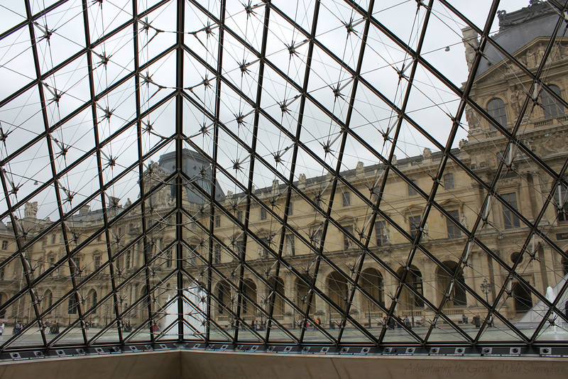 View of the Louvre courtyard, seen from inside the glass pyramid