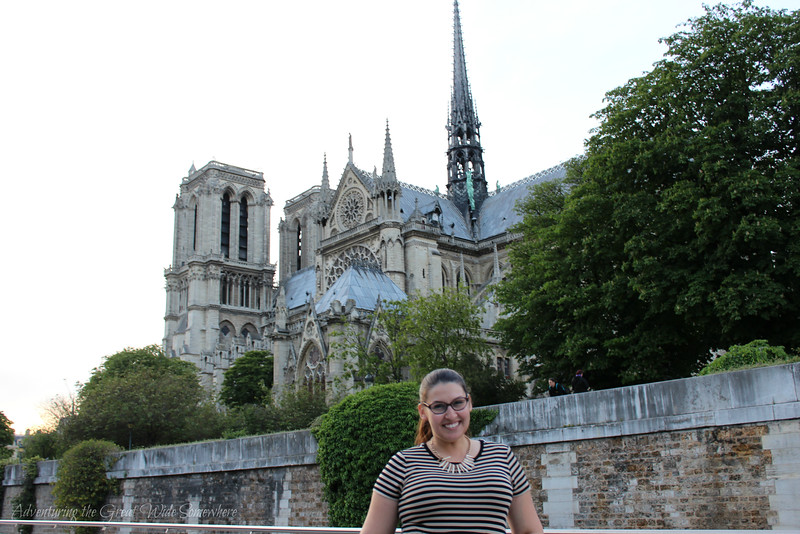 Smiling as we pass Notre Dame de Paris on our Bateaux Mouches dinner cruise