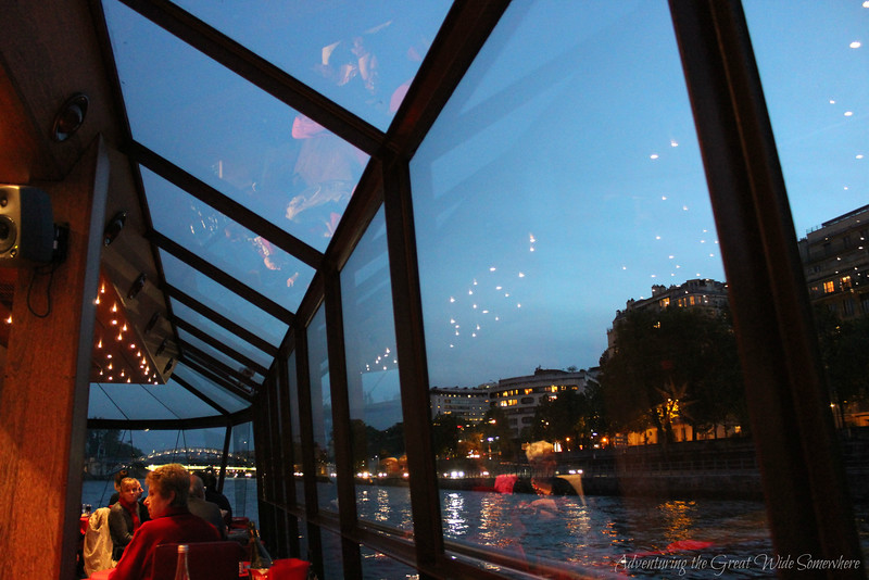 Paris at twilight, seen through the glass windows of the Bateaux Mouches dinner cruise.