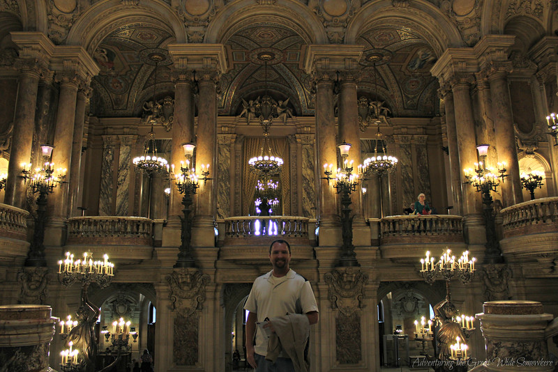 Dan standing at the top of the Grand Staircase inside the Palais Garnier