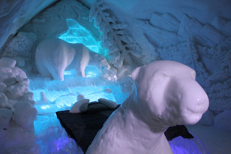 ice hotel room decorated with polar bear carvings