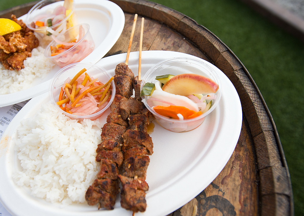 ginger pig lamb kebabs with rice and pickled vegetables