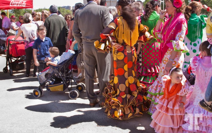 Waiting line to May Day Fair in Seville, Spain