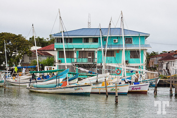 Turquoise building and sailing boats in the marina