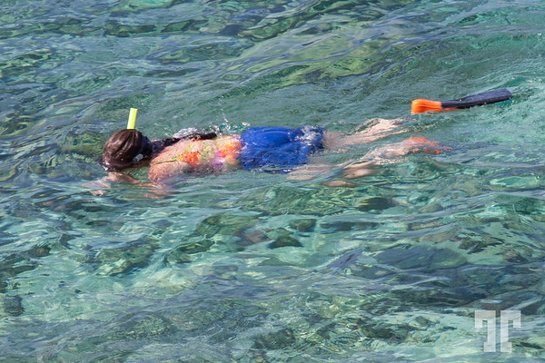Girl swimming and scuba diving