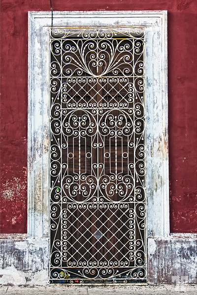 Mexican filigree metal artwork on adoor screen