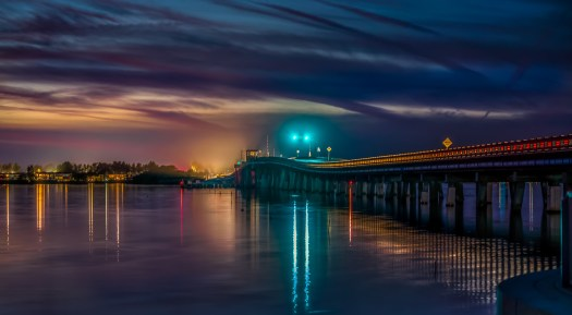 Lights from the Manatee Avenue bridge reflect on the water after dusk in Bradenton