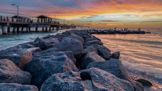 Rocks, Pier, Water and Sky