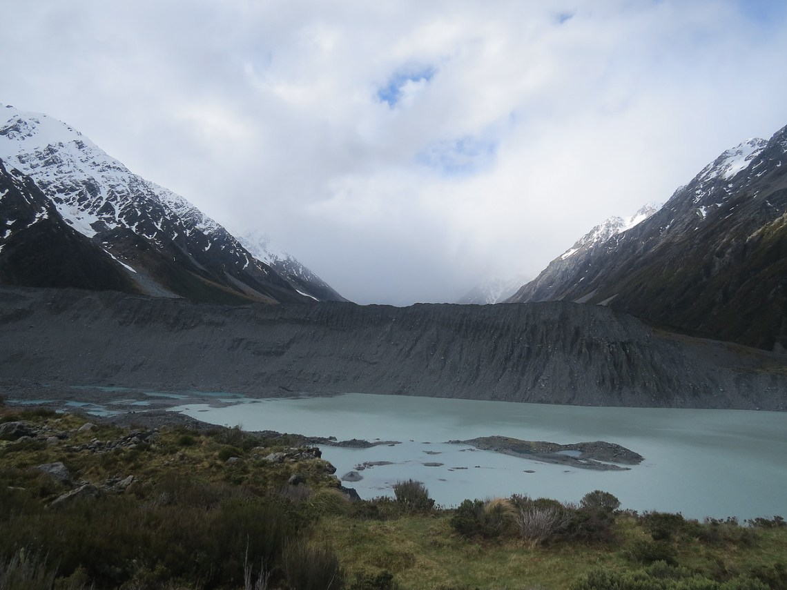 View of glacial moraine and the clouds covering Mount Cook