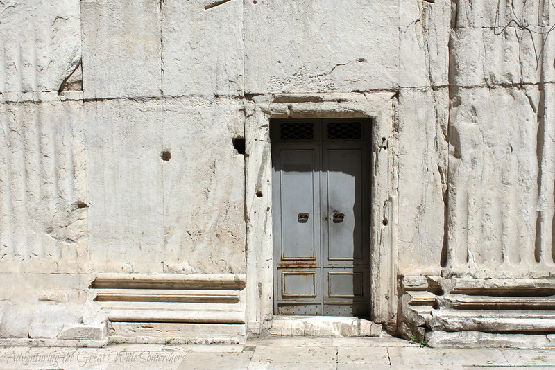 Slate gray door in the side of the Pantheon in Rome, Italy