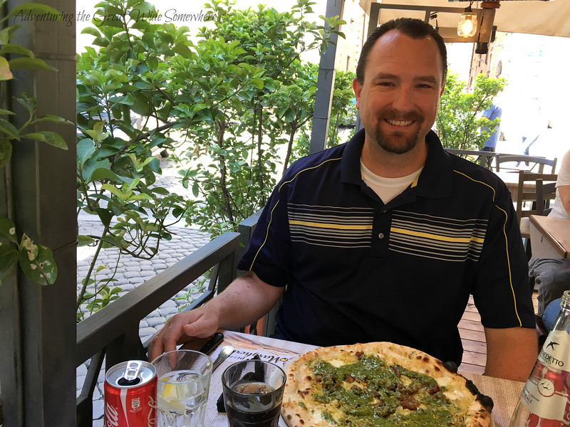Dan enjoying a sausage and pesto pizza at restaurant Margherita in Rome, Italy