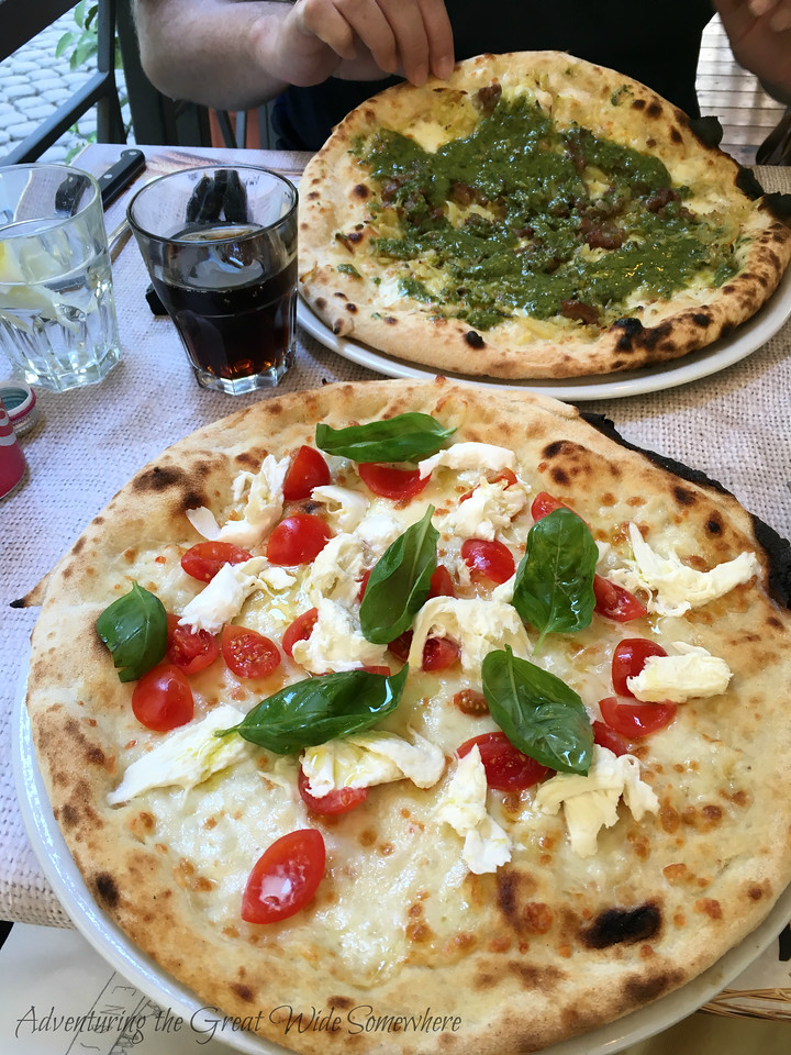 Sausage and pesto pizza and a tomato, basil and buffalo mozzarella pizza at restaurant Margherita in Rome, Italy