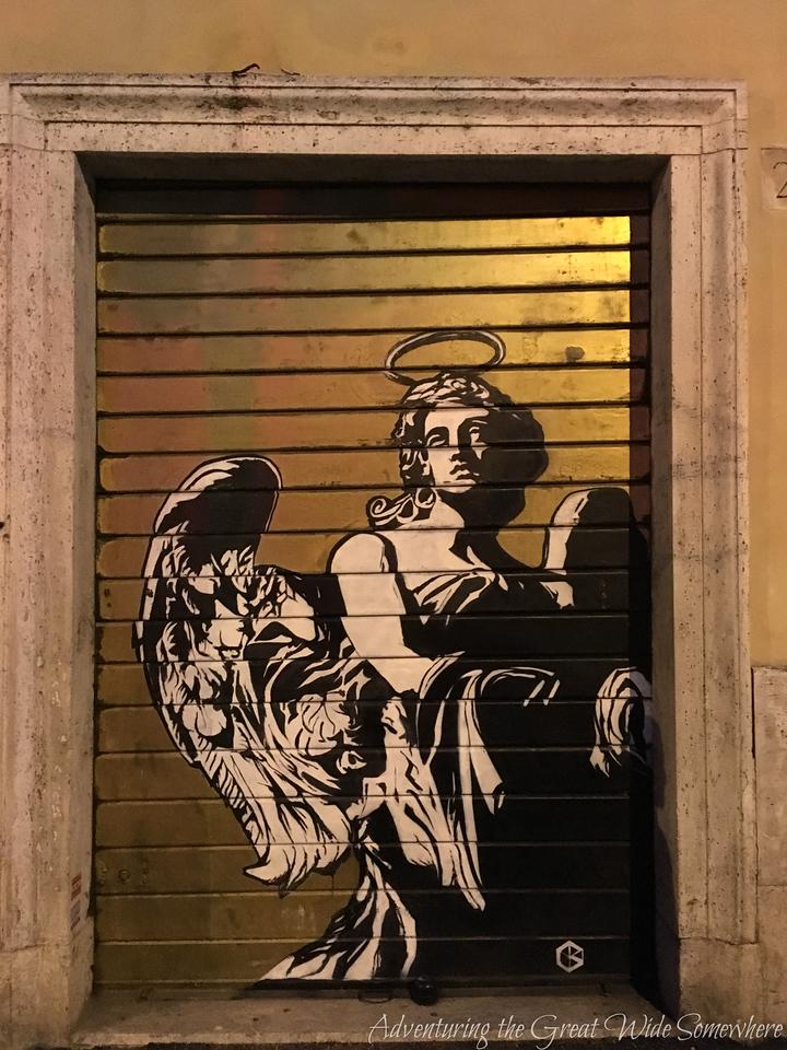 Street Art of an Angel on a Garage Door in Rome, Italy