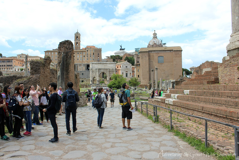 Tourists gather in the Roman Forum, the main square around which the rest of the site was built. Rome, Italy.