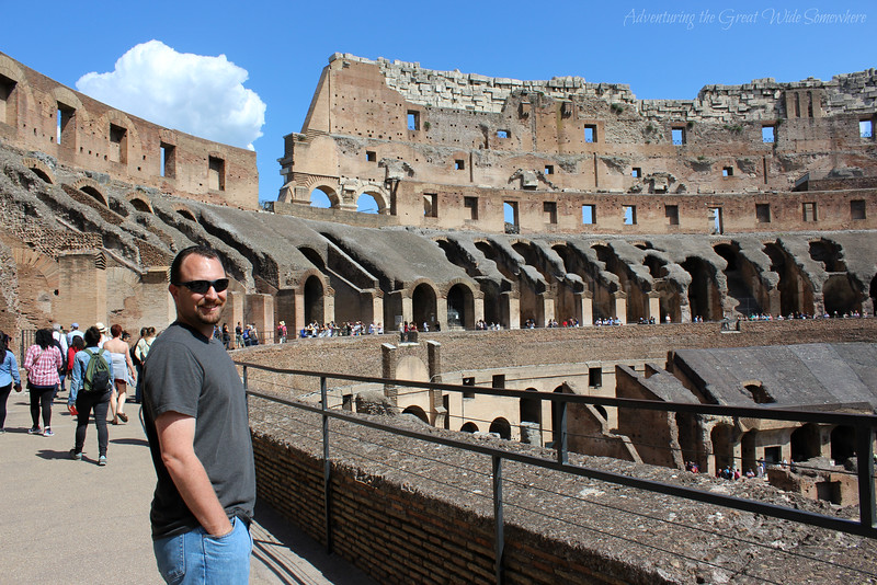 Dan smiling as he surveys the Colosseum arena.
