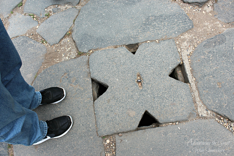 An ancient drainage system in the stone flooring of the Roman Forum walkways. Rome, Italy.