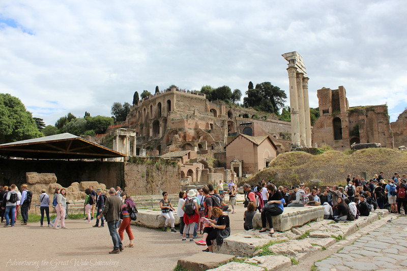 Tourists gather in the main square of the Roman Forum, Rome, Italy.