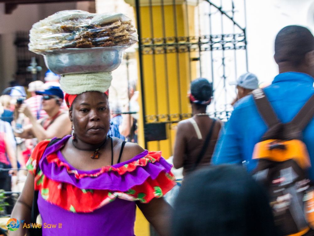 This beautiful Cartagenian woman skillfully carries her wares effortlessly on her head.