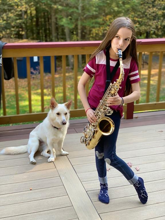 little girl playing saxophone