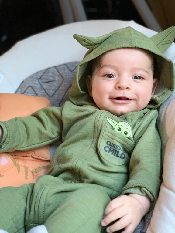 baby in Grogu Baby Yoda playsuit from Target