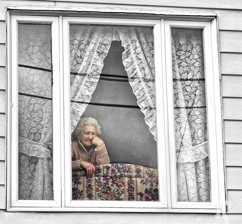 Elder lady looking out the window in St.John's Newfoundland