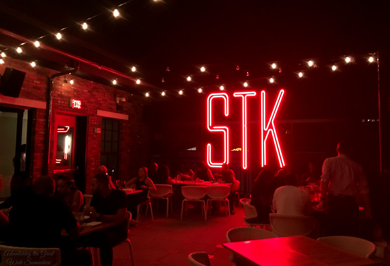 The Outdoor Patio with Neon STK Sign at STK Orlando, Disney Springs