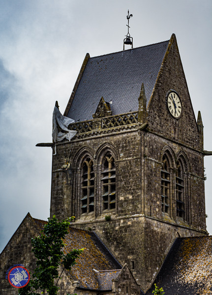 The Church Tower at Ste. Mere-Eglise with a Replica of Private John Stone Hanging from his Parachute that Caught on the Tower (©simon@myeclecticimages.com)