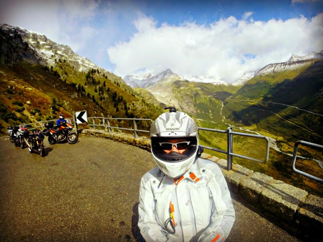 Standing on the Grimsel pass with the Furka pass in the background
