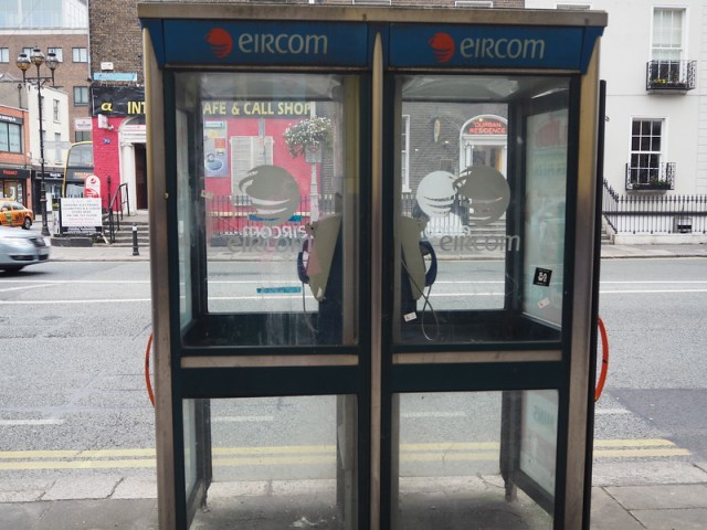 A pair of Irish phone boxes on a Dublin street.