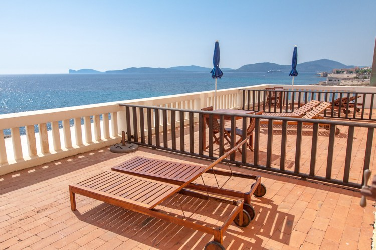 Villa las Tronas is a romantic, luxury retreat by turning an old castle into a hotel. The perfect accommodation when visiting Sardinia, Italy. Check out our pros & cons! | www.eatworktravel.com - The luxury, adventure couple!