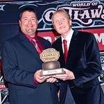 Arnie Rantz accepts 10th place points trophy for Brett Larson