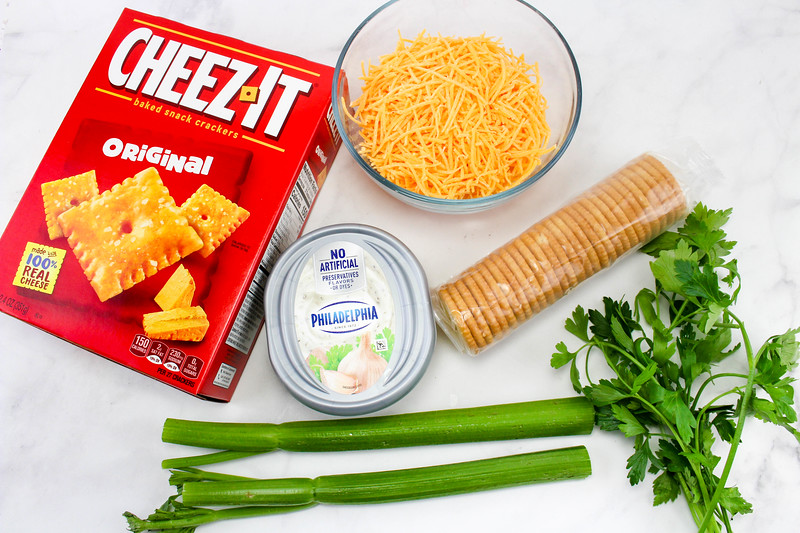 Pumpkin Cheese Ball Recipe with cream cheese, cheddar cheese, crackers, celery, parsley