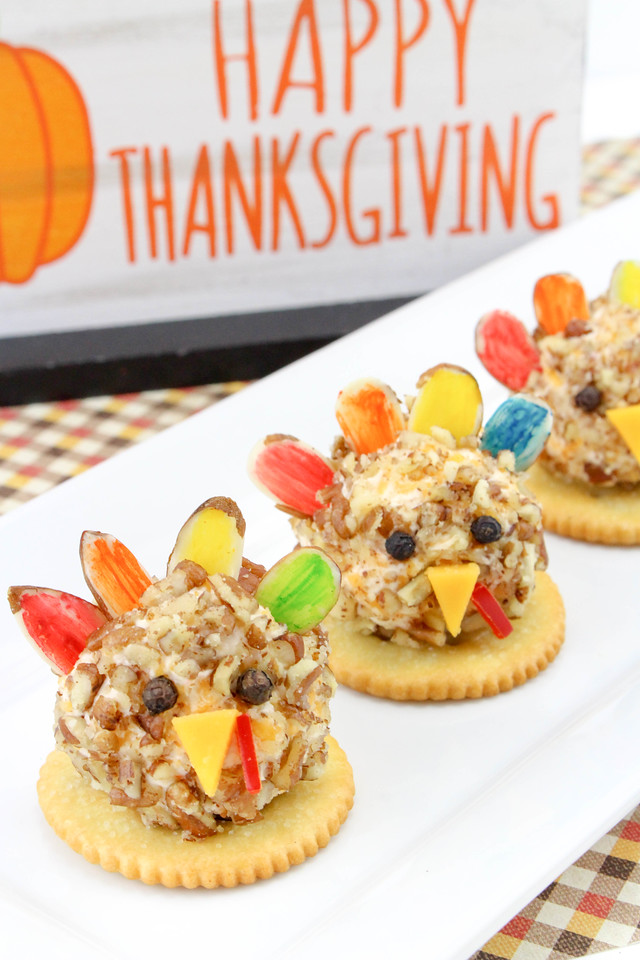 These Thanksgiving Turkey Cheese Balls will be the hit of any Fall and Thanksgiving feast. The #recipe requires a few ingredients and will be enjoyed by all