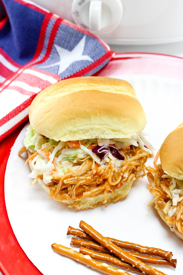 These Slow Cooker Hawaiian BBQ Pulled Chicken Sandwiches are easy to make and will be the talk of your spring, summer, birthday, Memorial Day, Fourth of July, or graduation party. The sky is the limit! #recipes #slowcooker #pulledchicken #partytime