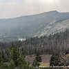 Finally on the other side of the ridge and we get a small peek at Slide Lake. The smoke has also thickened.