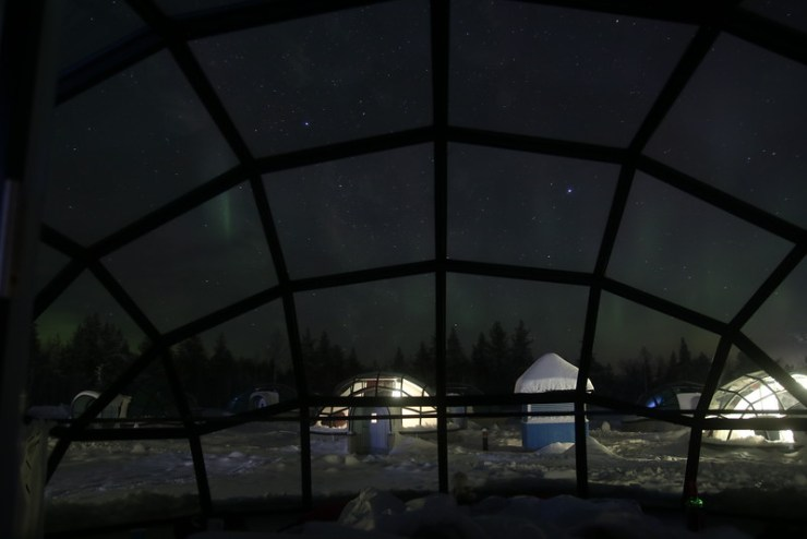 aurora from inside glass igloo in kakslauttanen