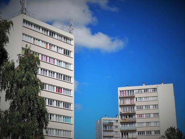 Modern apartment blocks with multi-coloured window dressings.