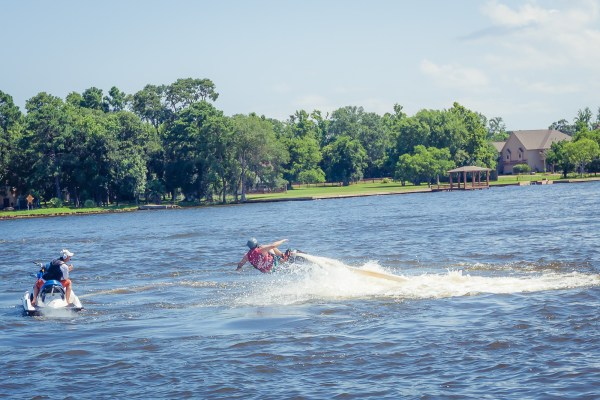 Summer is the perfect time to explore the water. Having a board strapped to your feet with a water stream propelling you in the air? Check out the water sports we found at Lake Conroe, TX | www.eatworktravel.com