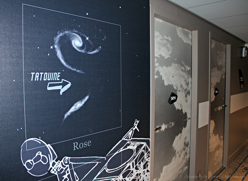 Space themed hallways show constellations and more in the charming airport hotel Ibis Styles CDG. Paris, France.