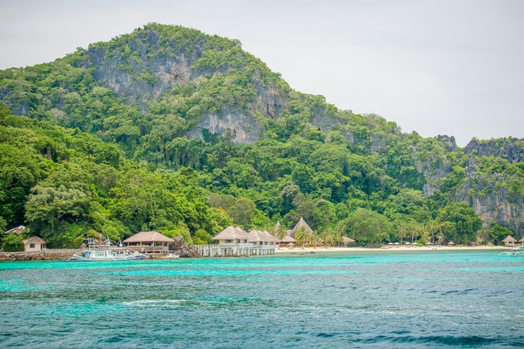 If you are looking for paradise, a visit to El Nido in the Philippines is a must. El Nido Apulit Island Resort offers a unique location with rooms that are huts over the water.