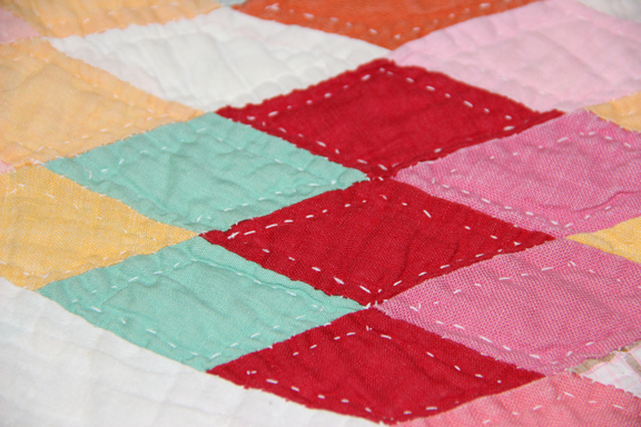 Detail of hand-quilted pieces on the Ida Grady Sunburst quilt