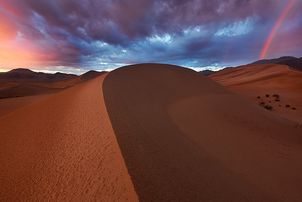 Ibex dunes rainbow and sunset by Ron Coscorrosa