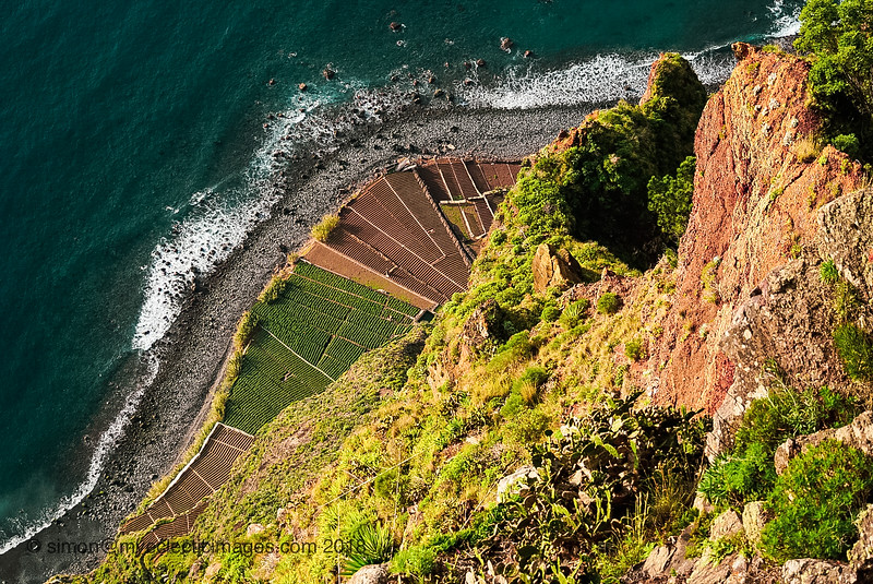 Looking Straight Down to the Seashore from the Cliffs at Miradouro do Cabo Girao (©simon@myeclecticimages.com)