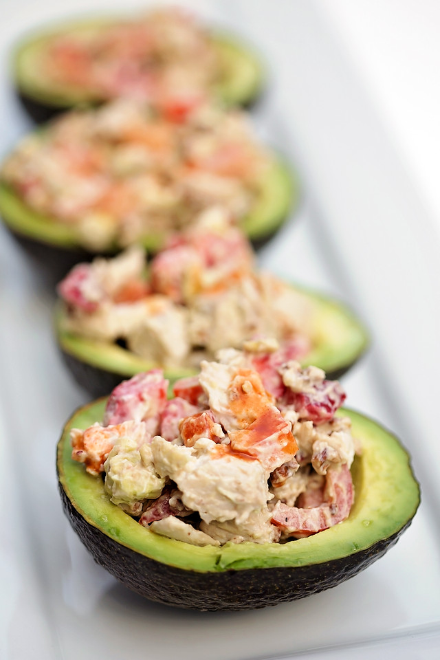 These Spicy Chicken Salad in Avocado Bowls are the perfect #recipe for your big game day! And enter the #giveaway for a $1,000 gift card! Such an amazing recipe and an amazing prize to win! #ad #GuacWorld #FlavorYourWorld http://bit.ly/2p8H3ky