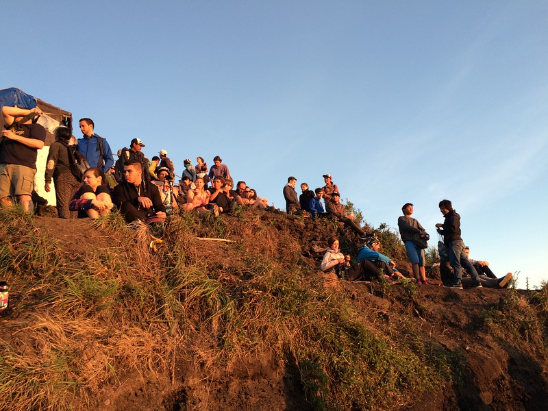 The Reality of Visiting Mount Batur, Bali: Crowds of Fellow Trekkers at the Summit. Photo Credit: Sarah Berthe