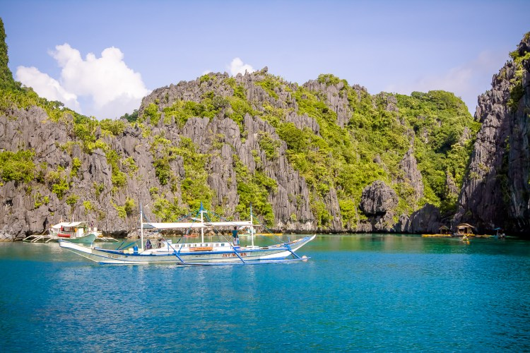 The ultimate activities when visiting El Nido, Philippines is to take island hopping tours to see the lagoons and coves in the area. We've compiled a list of our favorite spots to help you choose the best El Nido island hopping tour for you.