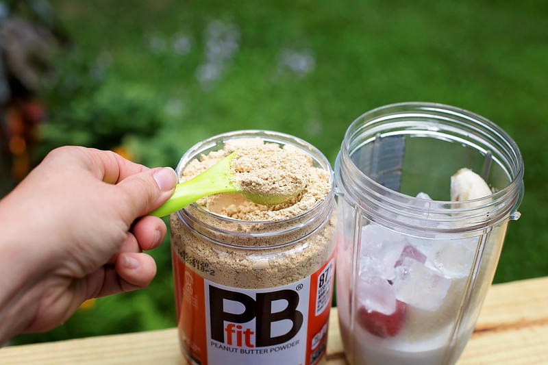 #ad This peanut butter and jelly and banana smoothie is so creamy and delicious. I make it with PBfit, so it has 1/3 the calories of regular peanut butter.
