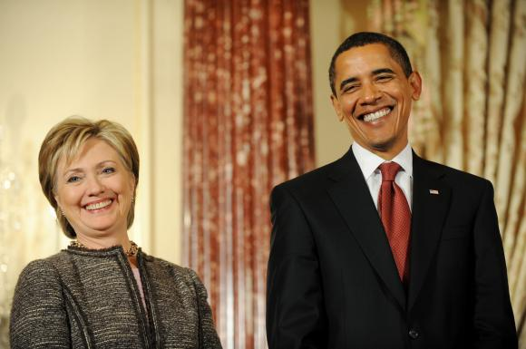Hillary and the President share a laugh
