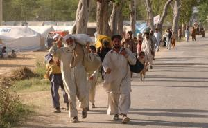 Local residents flee from Mingora, the main town of Pakistan's troubled Swat Valley, to Mardan, Pakistan on  May 11, 2009.  About 360,000 people have left the troubled region as the fight continues between the Pakistani army and the Taliban. (UPI Photo/Sajjad Ali Qureshi)